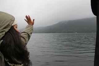 Sacheem Seitcham waves away salmon farms